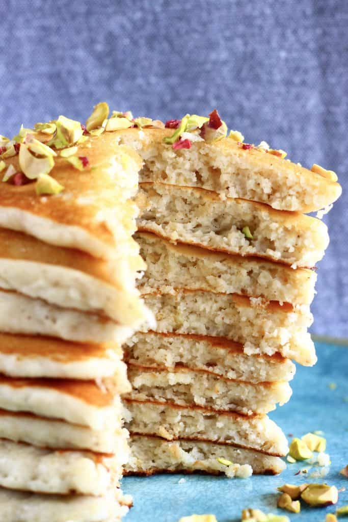 A stack of oatmeal pancakes with a mouthful cut out of it