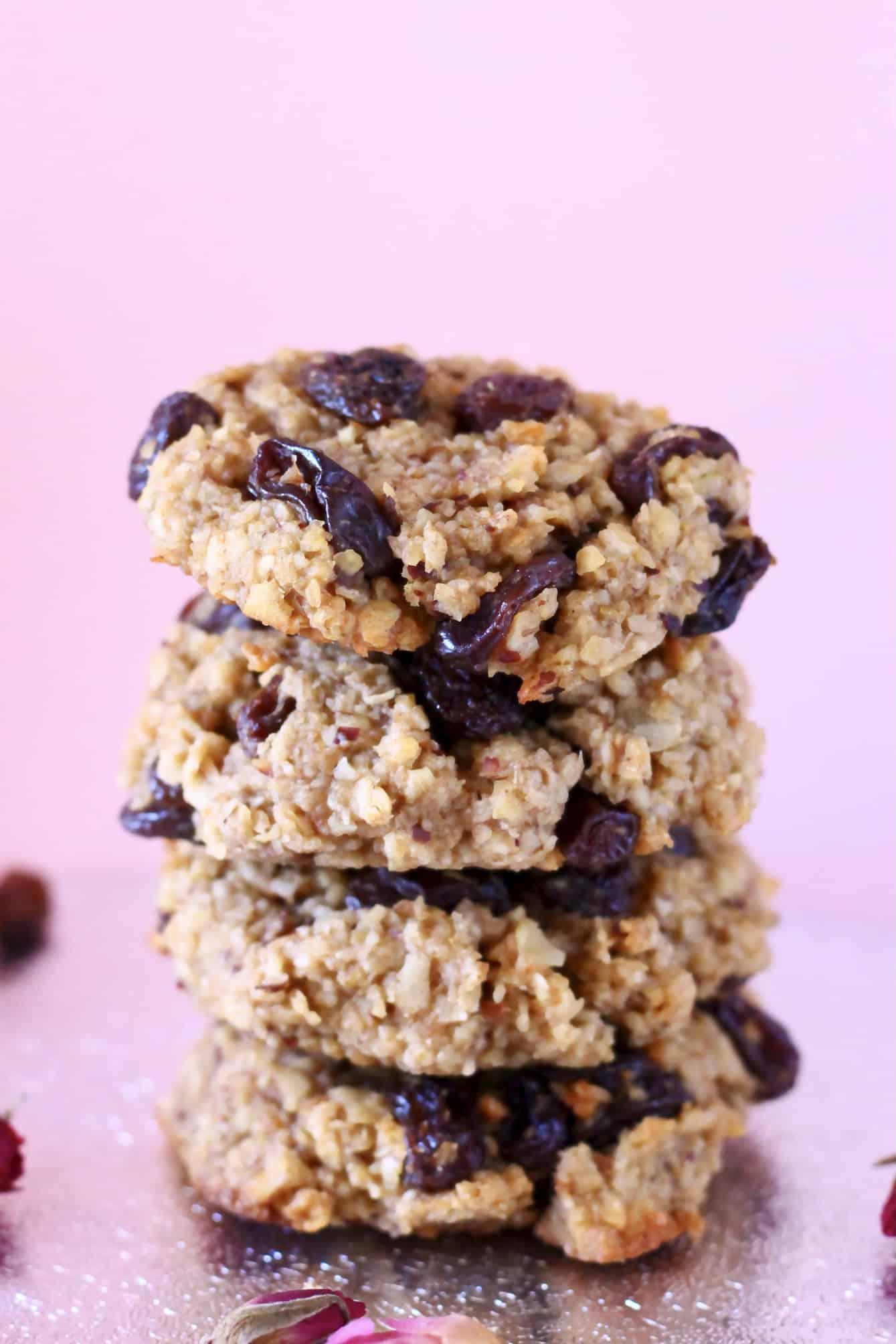 A stack of four gluten-free vegan oatmeal raisin cookies