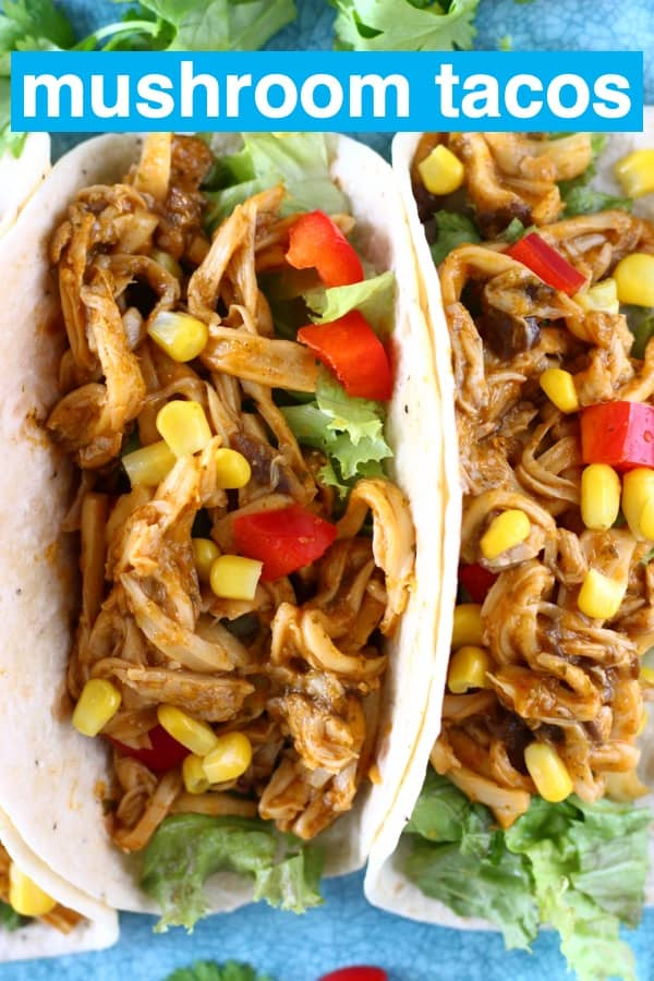 Shredded mushroom tacos with sweetcorn and red pepper on a blue plate