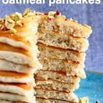 A stack of sliced oatmeal pancakes on a blue plate against a grey background
