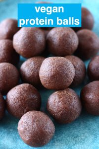 A pile of chocolate protein balls on a blue plate