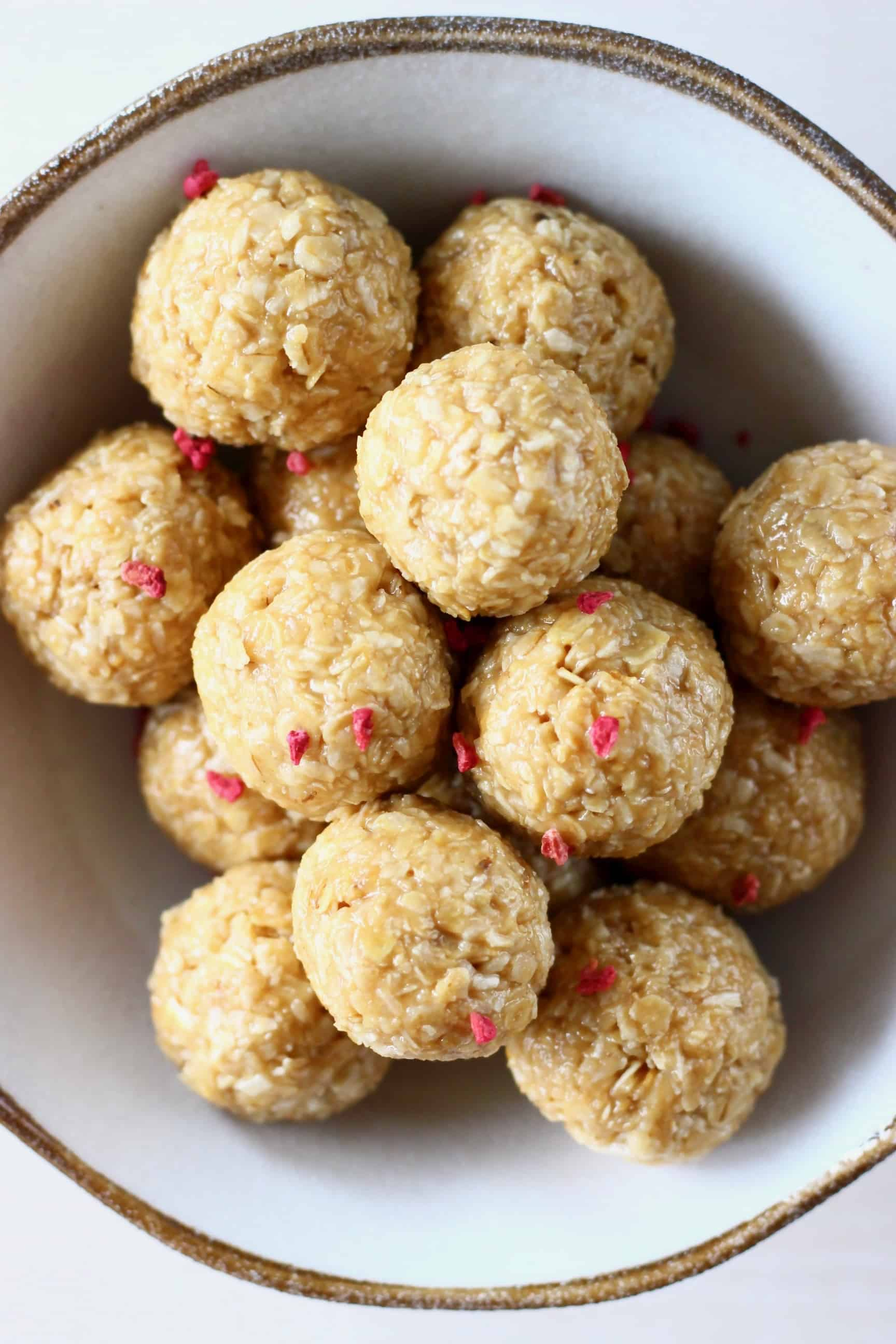 A pile of no-bake energy bites in a bowl