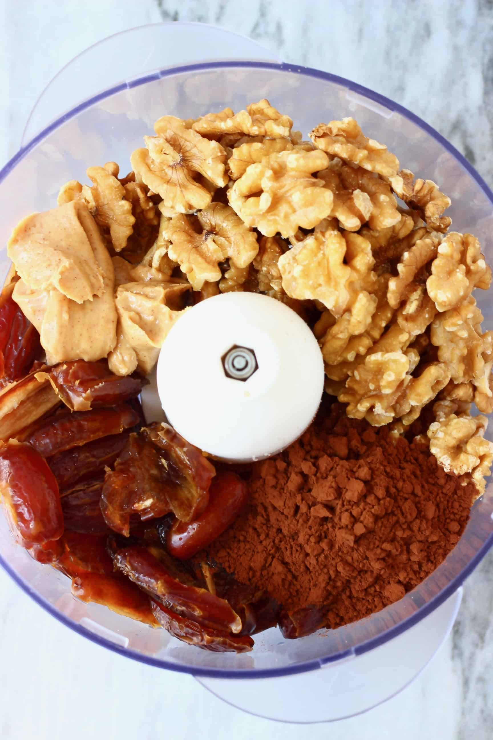 Dates, peanut butter, walnuts and cocoa powder in a food processor