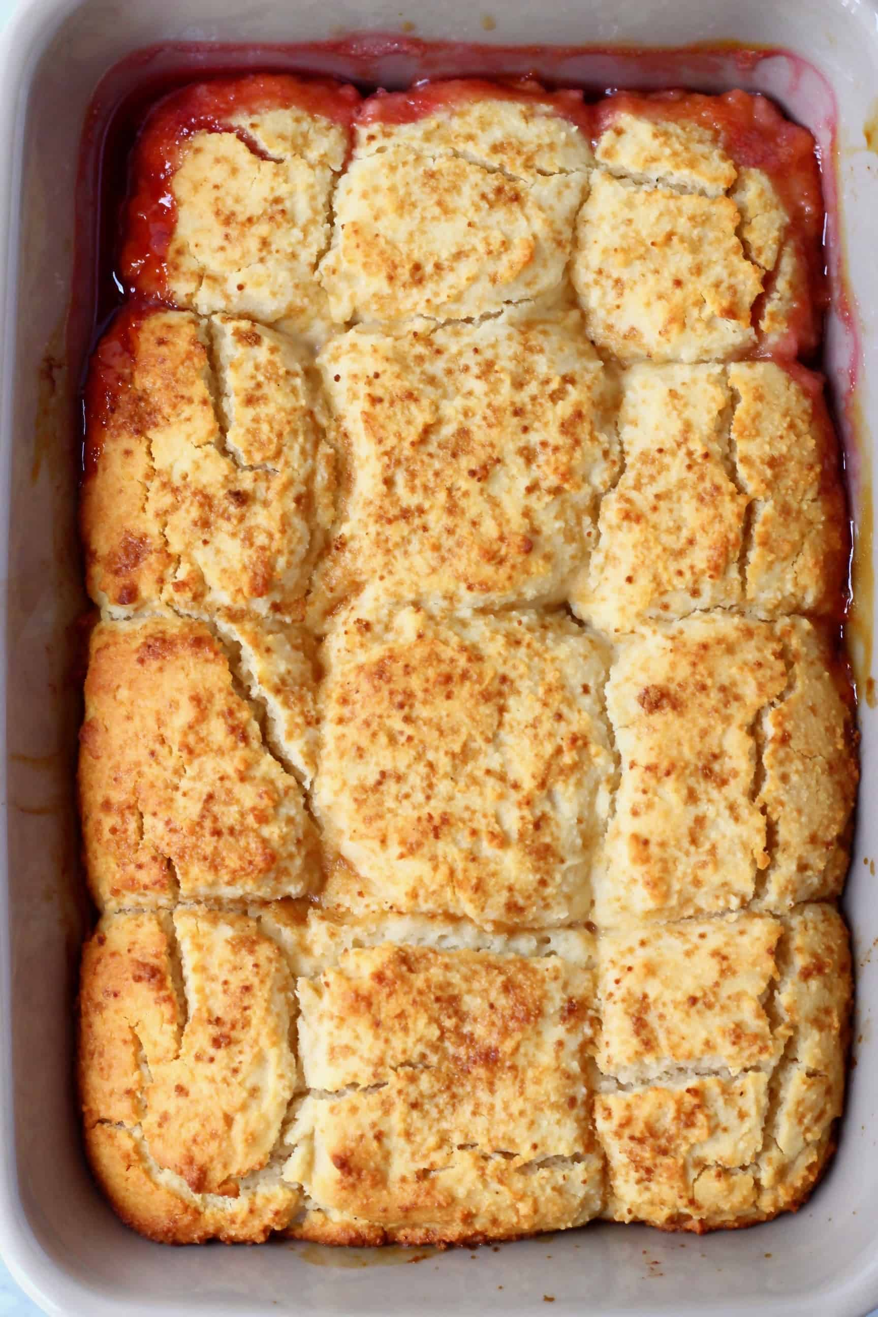 Peach cobbler in a rectangular grey baking tray