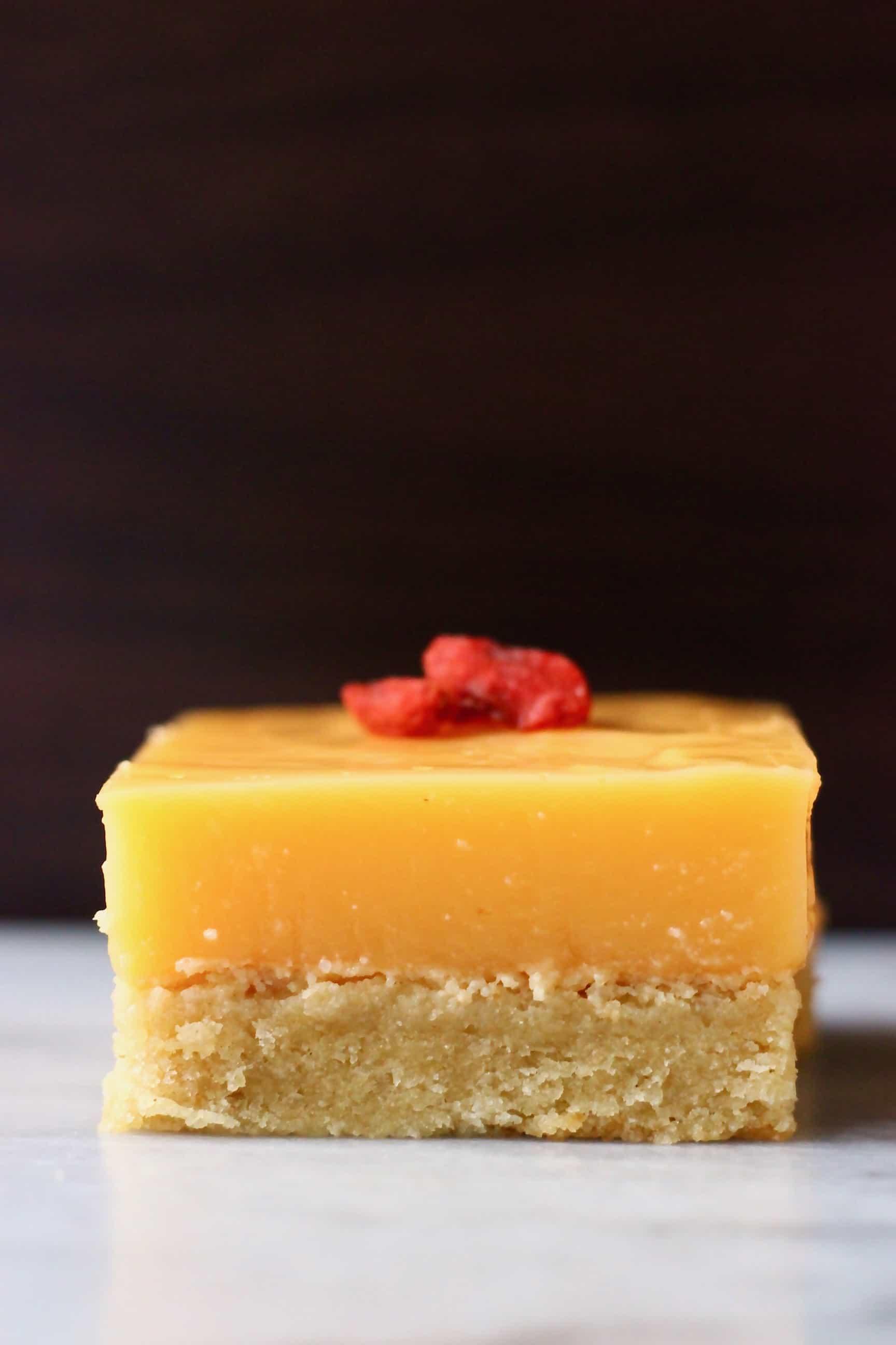 A gluten-free vegan lemon bar topped with goji berries
