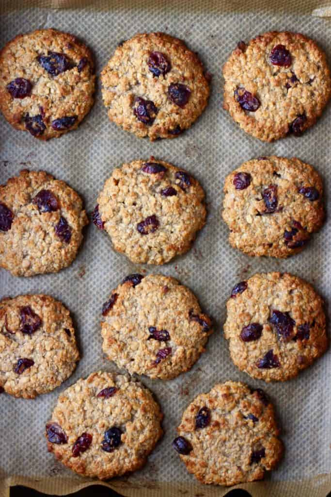 11 oatmeal cookies with dried cranberries on brown baking paper
