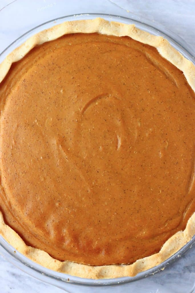 Cooked sweet potato pie in a glass pie dish