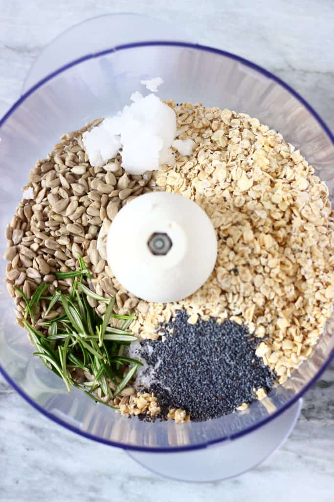 Oats, sunflower seeds, rosemary, poppy seeds, coconut oil and salt in a food processor