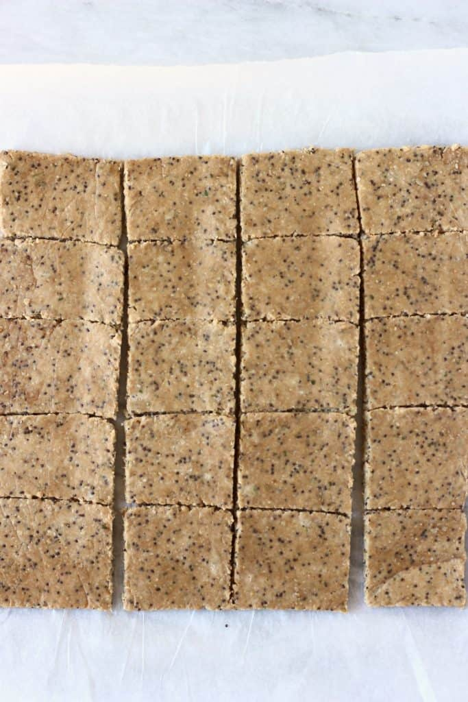 Squares of brown cracker mixture on white baking paper