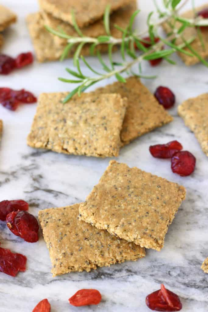 Several brown square crackers on a marble background