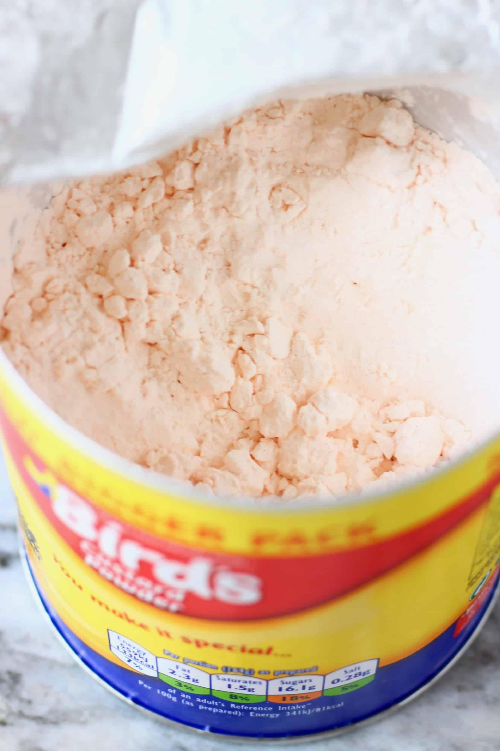 A tin of Bird's custard powder with the lid open