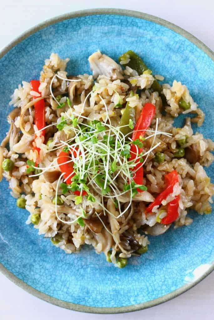 Mushroom rice with peppers on a blue plate