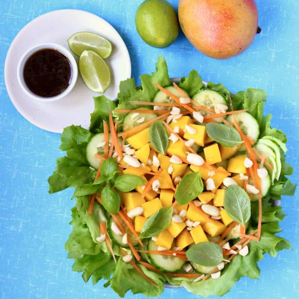 Mango salad with peanuts, cucumber, lettuce, carrots and basil