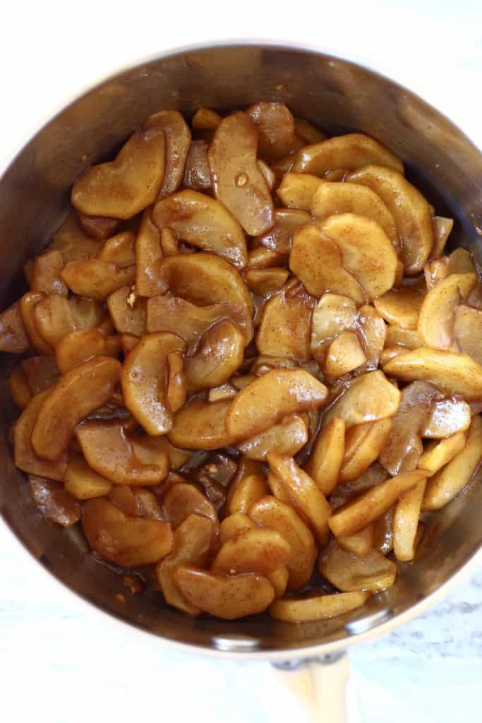 Cooked brown sliced apples in a saucepan