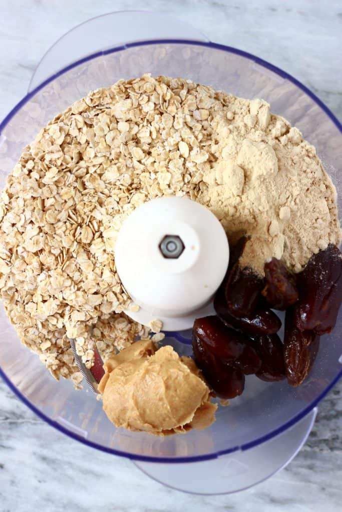Oats, protein powder, peanut butter and dates in a food processor