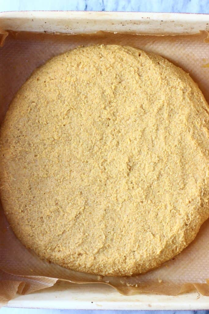 A circle of pumpkin scone dough in a baking tray