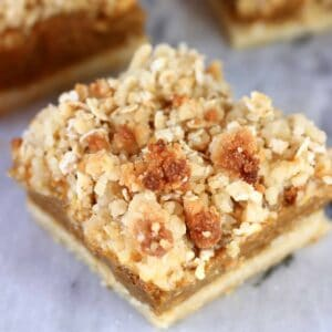 A vegan pumpkin pie bar with crumble topping