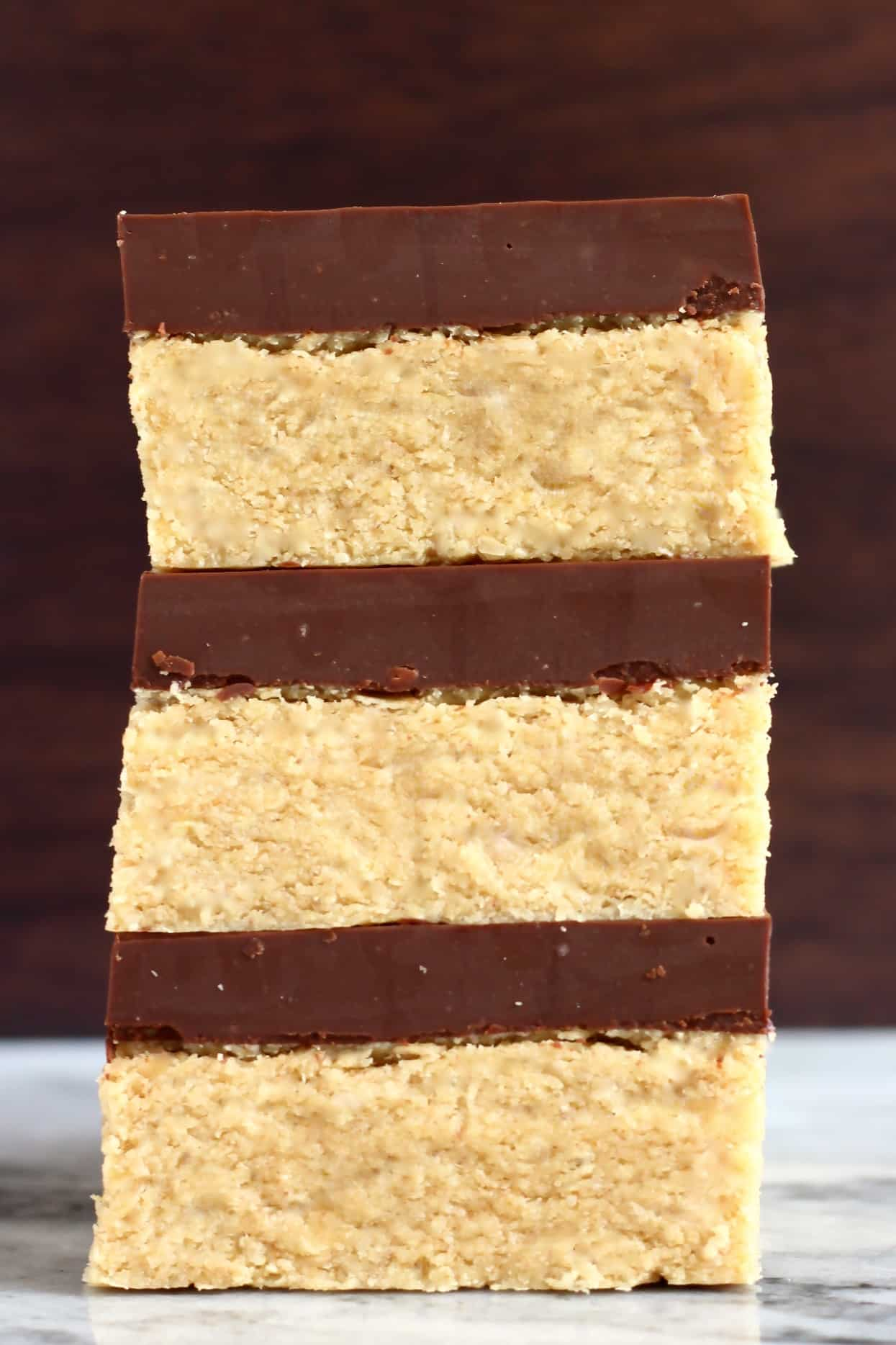 A stack of three chocolate peanut butter bars
