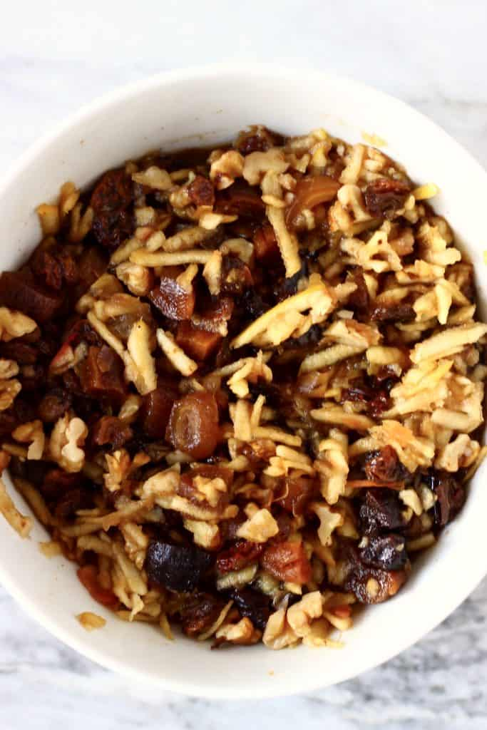 Mincemeat made with dried fruits, grated apples and nuts in a white bowl