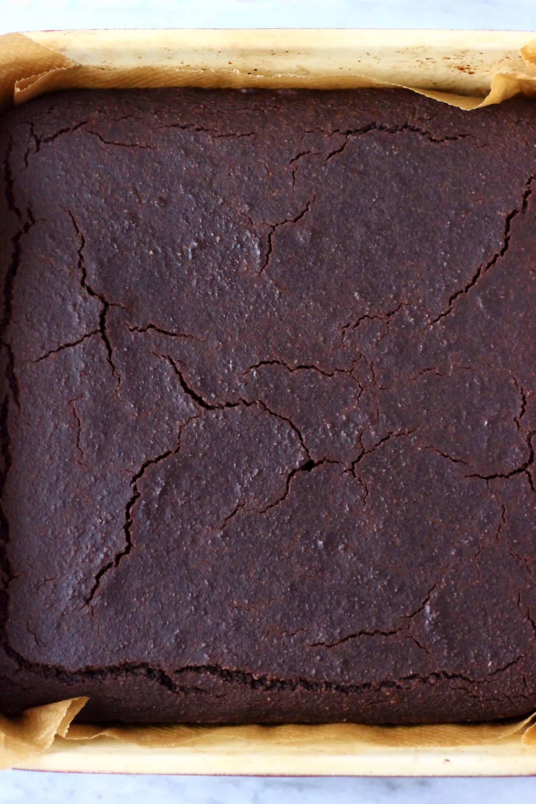 Gluten-free vegan yule log chocolate sponge in a square baking tin