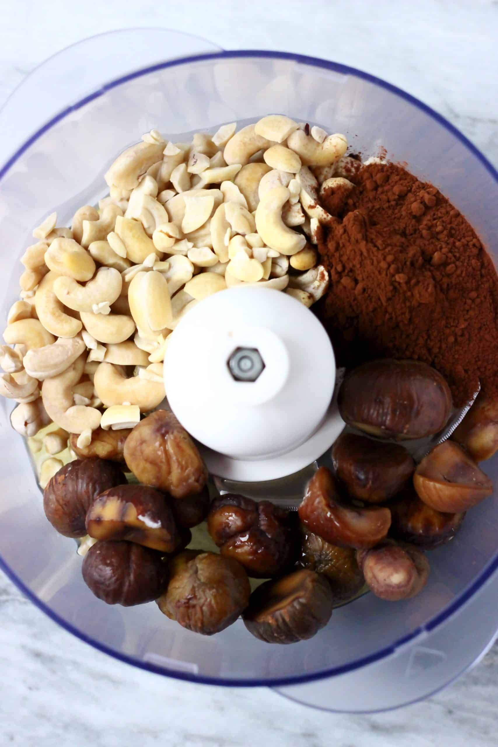 Cashews, cocoa powder and chestnuts in a food processor