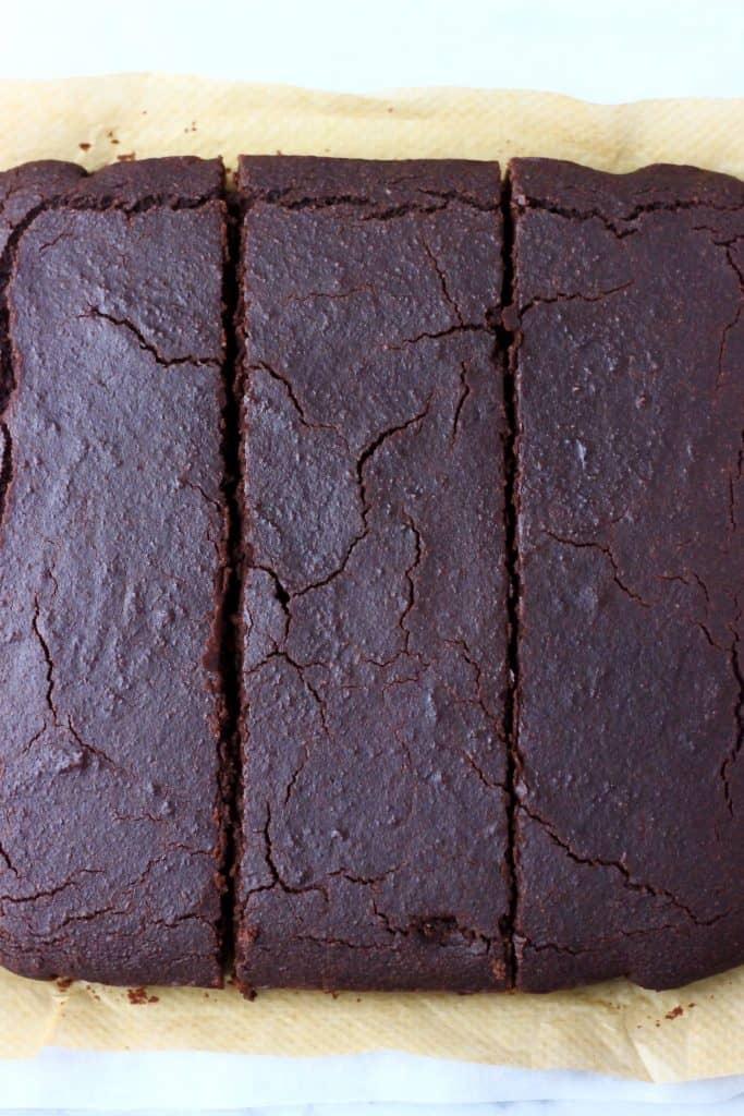 Square chocolate sponge cake cut into three