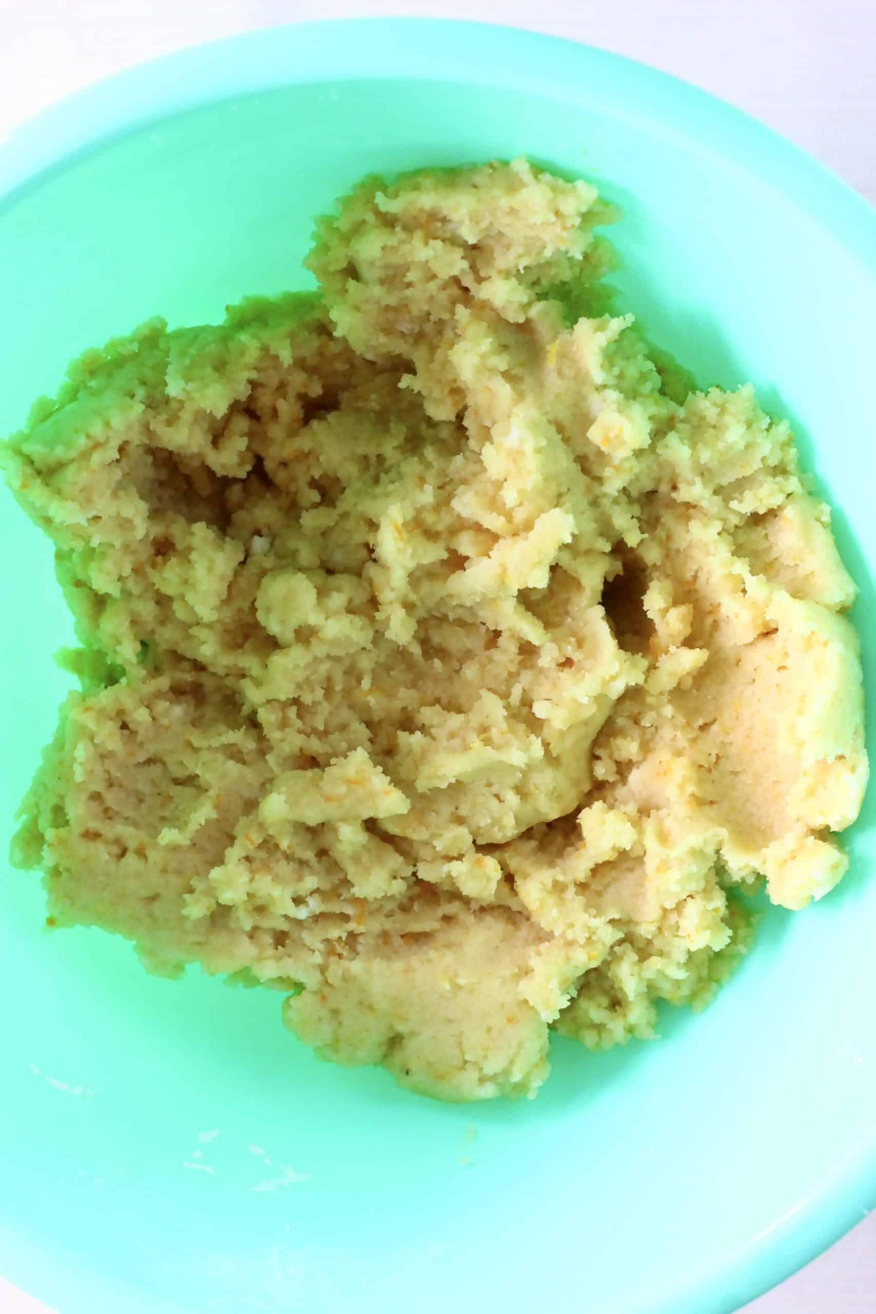 Raw gluten-free vegan orange cookie dough in a mixing bowl