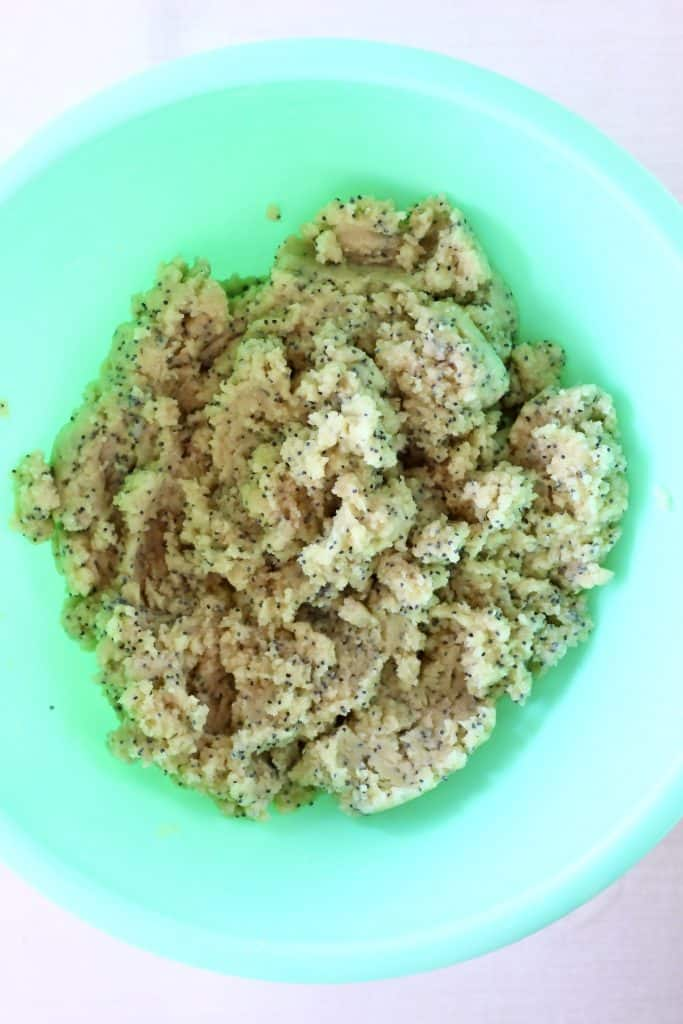 Raw lemon poppy seed cookie dough in a mixing bowl