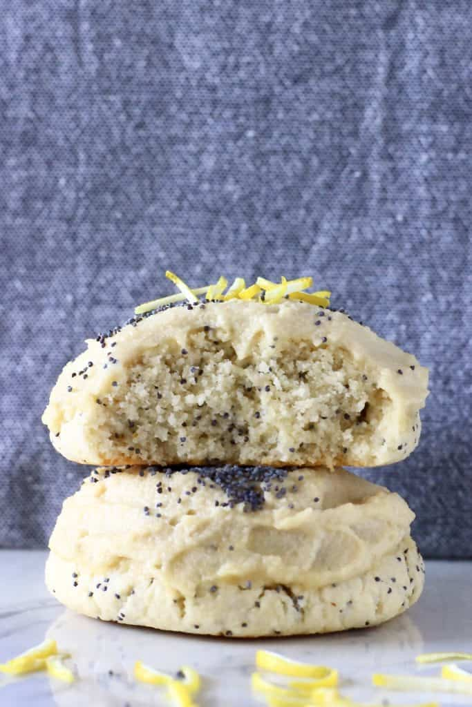 Two lemon poppy seed cookies stacked on top of each other with a bite taken out of one