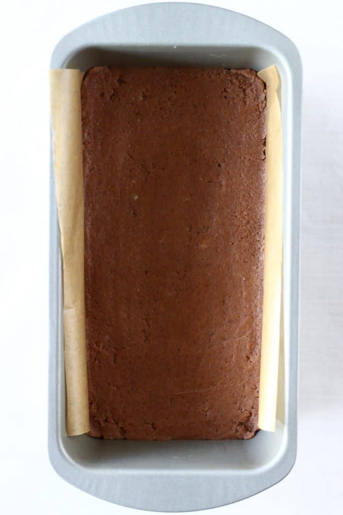 Raw gingerbread cookie dough in a loaf tin