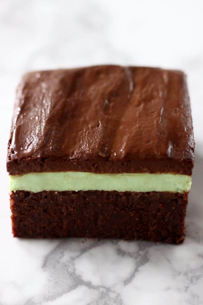 A brownie with green peppermint cream and chocolate ganache