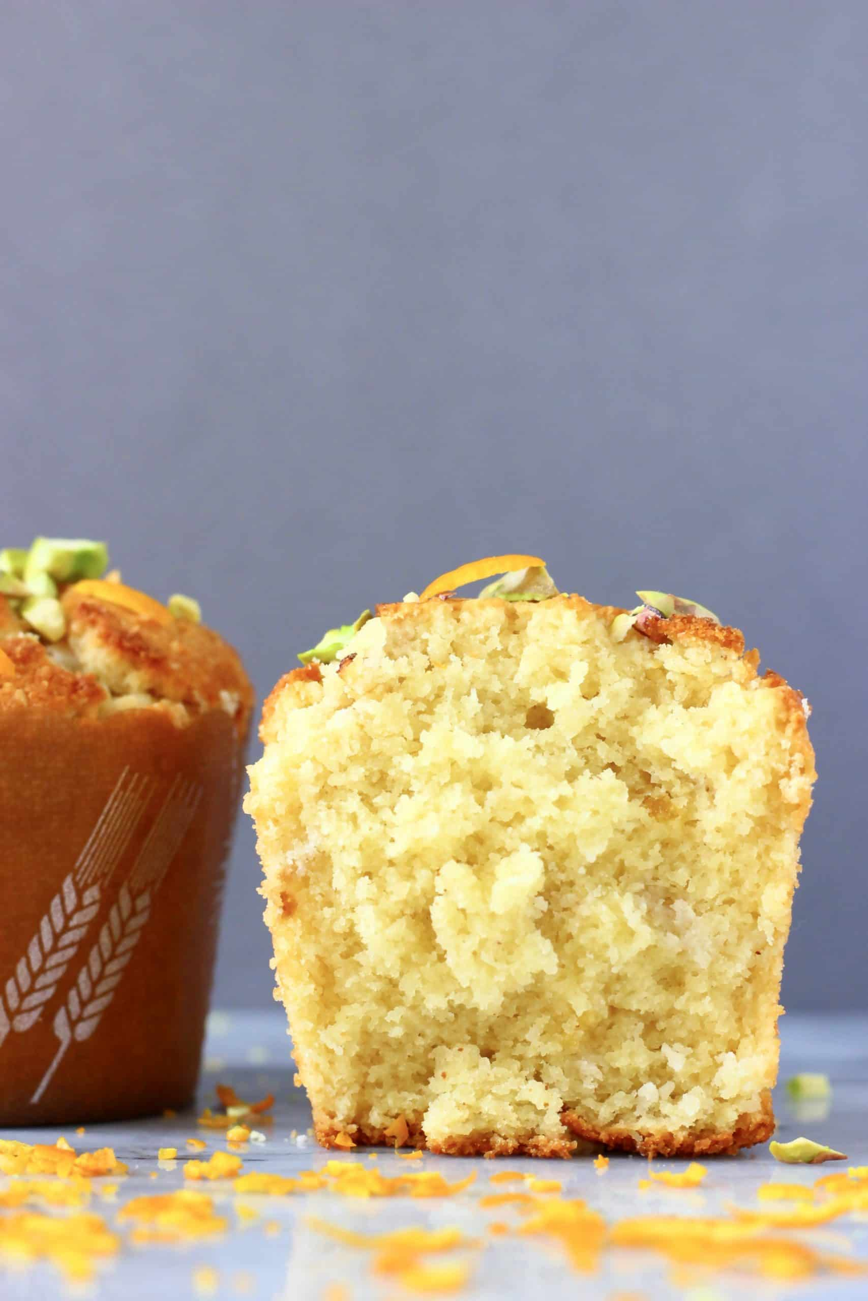 Two gluten-free vegan orange muffins, one cut in half