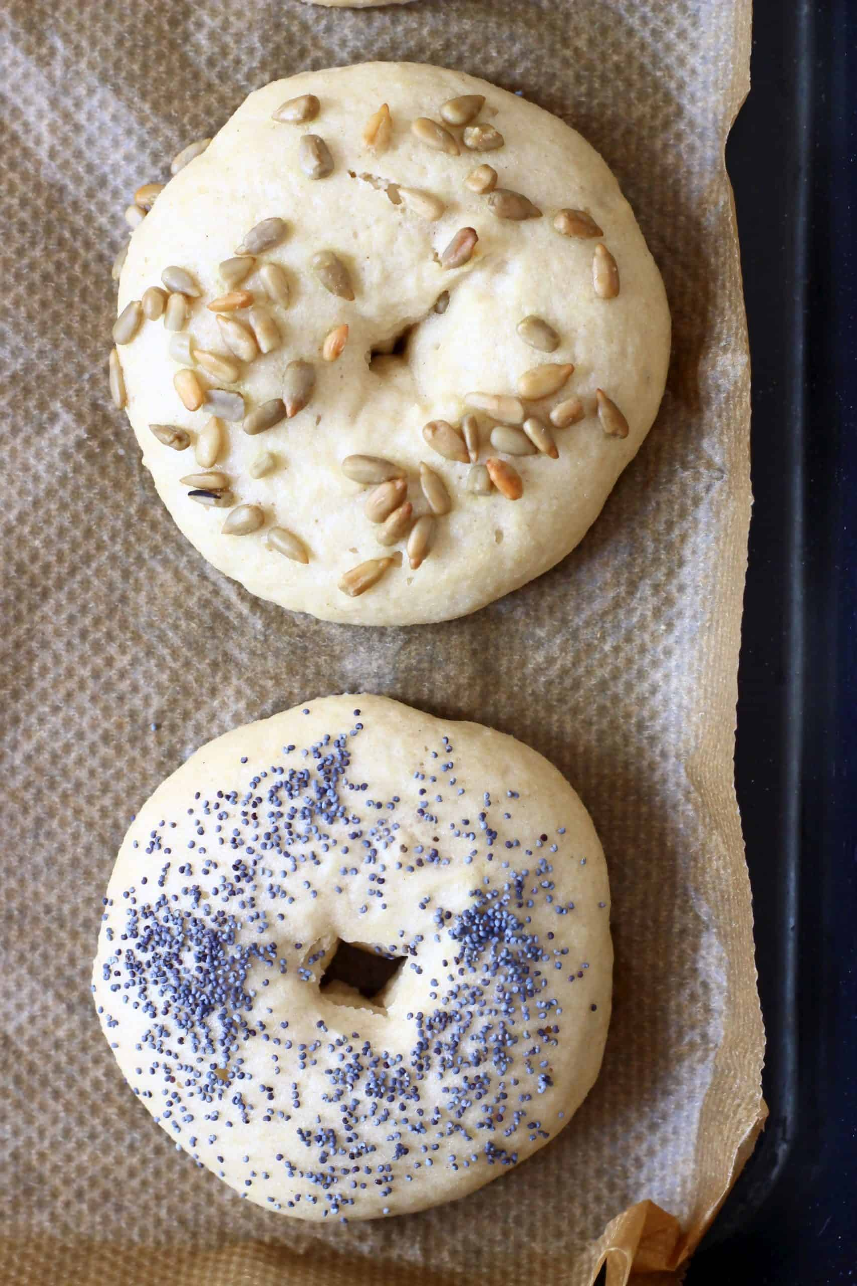 Two bagels on a sheet of brown baking paper