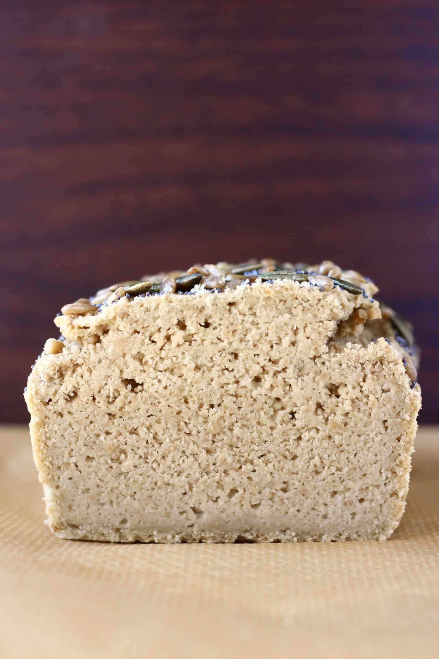 A sliced loaf of sunflower seed bread