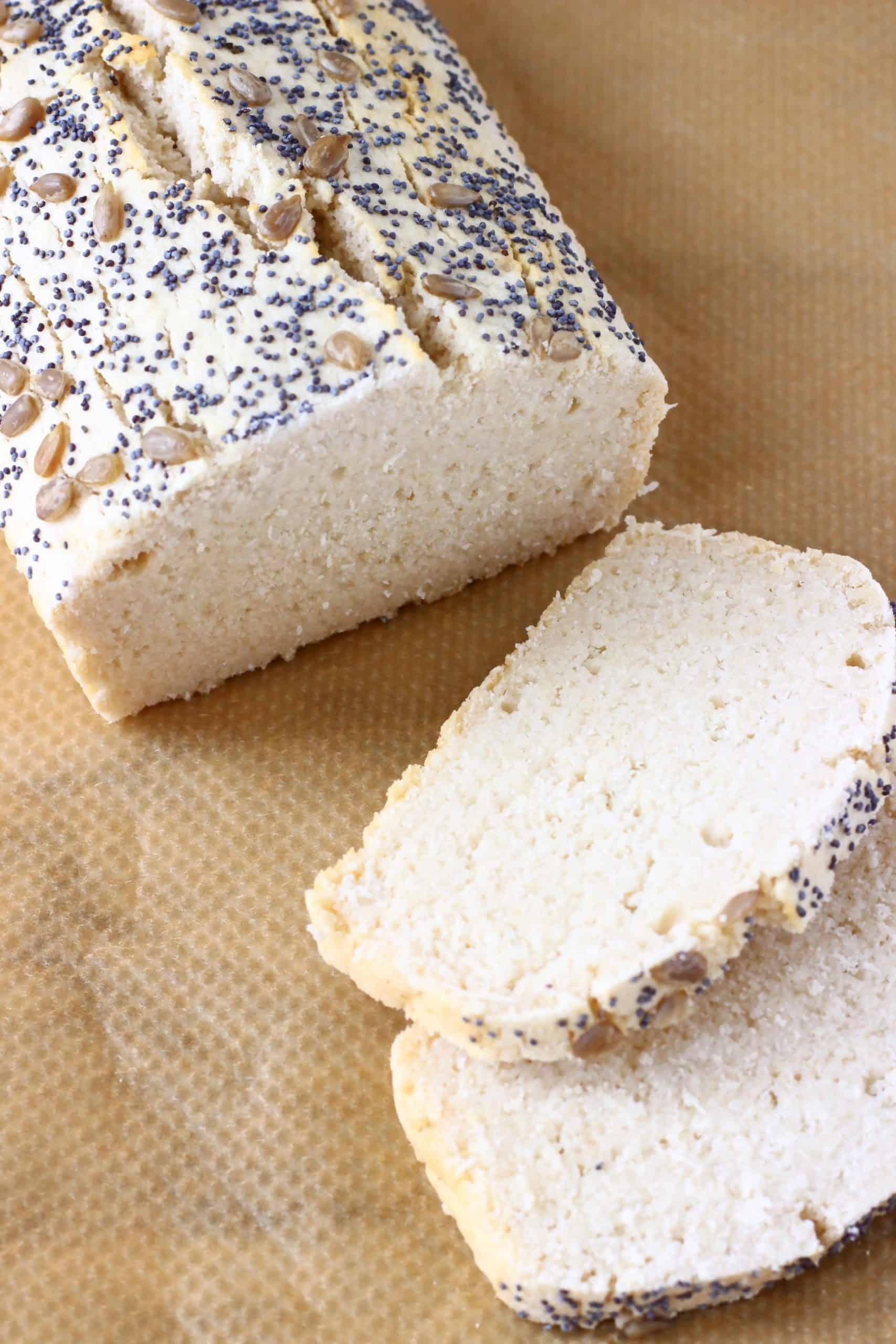 A loaf of rice flour bread with two slices next to it