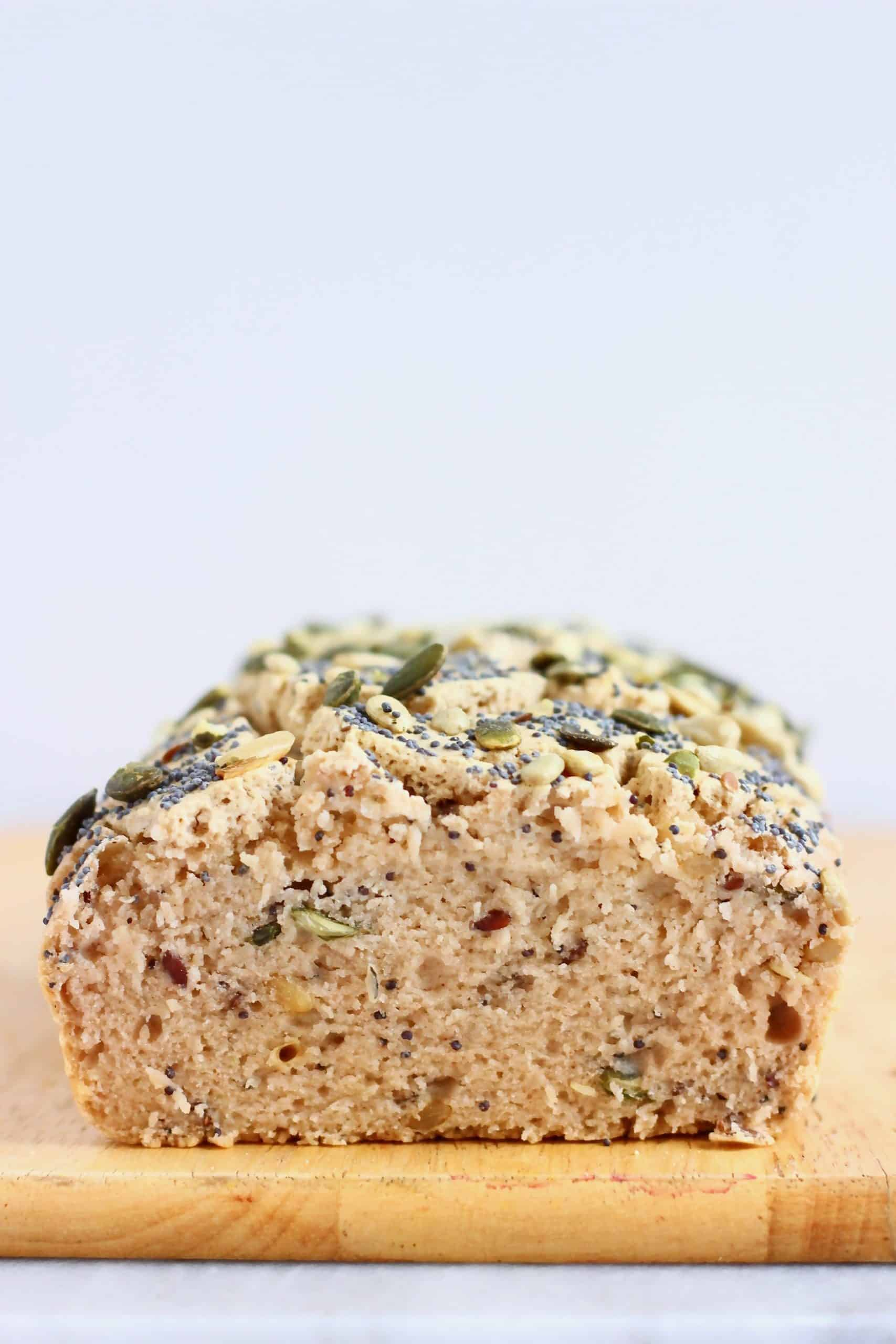 A loaf of buckwheat bread topped with seeds