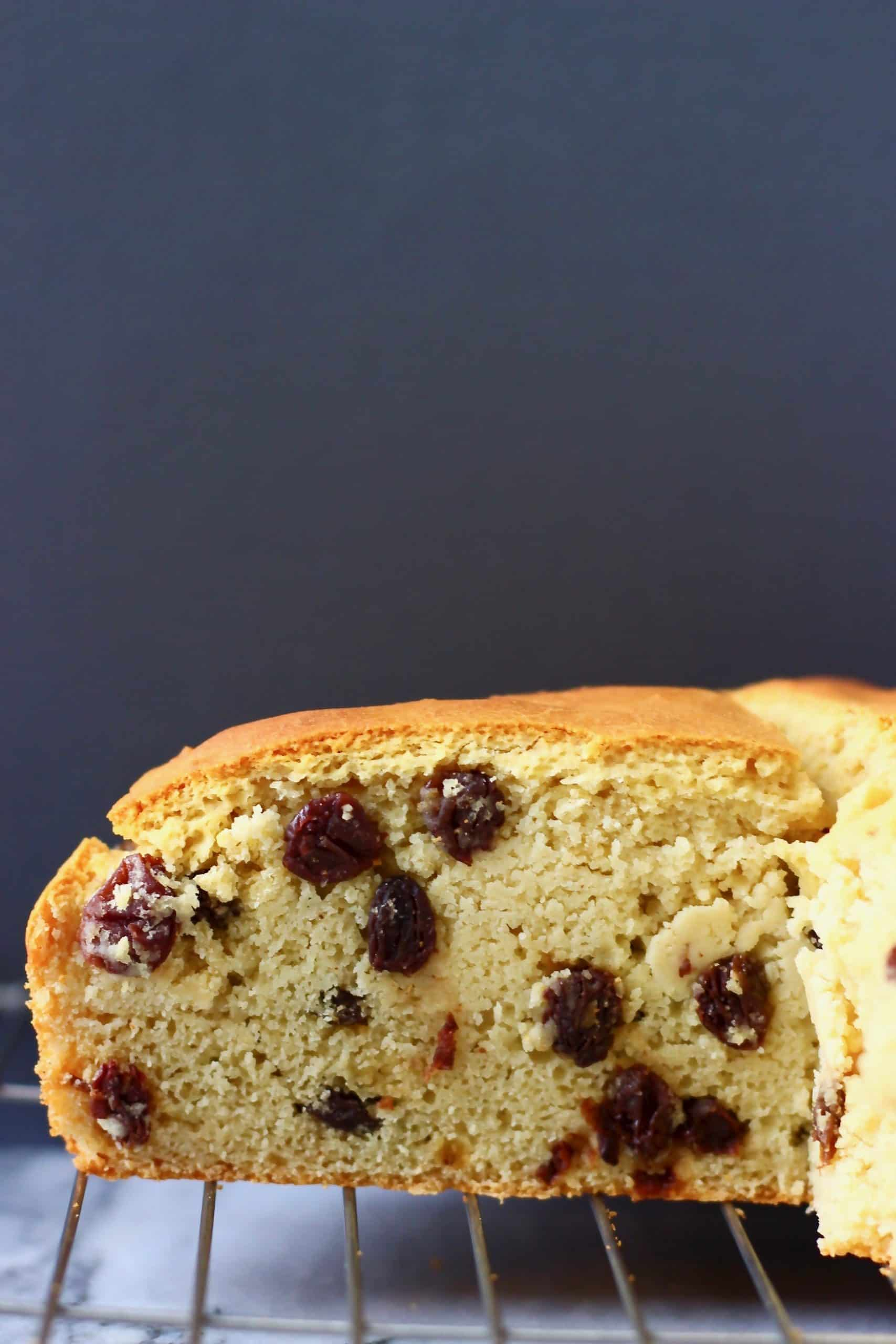 A sliced round loaf of soda bread with raisins