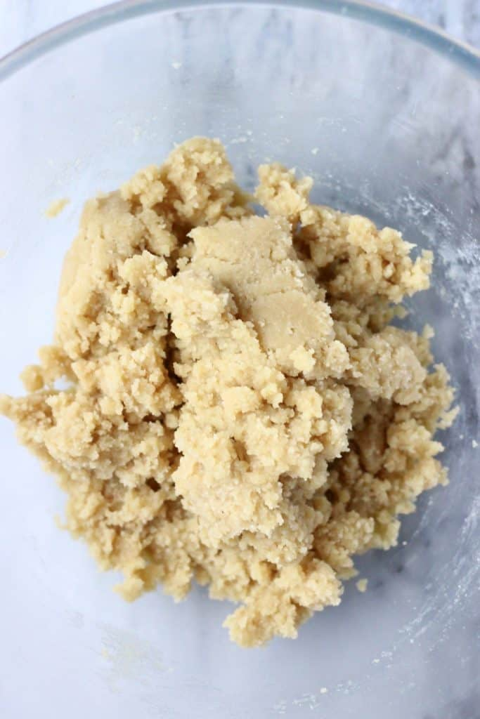 Raw crumble bar dough in a mixing bowl