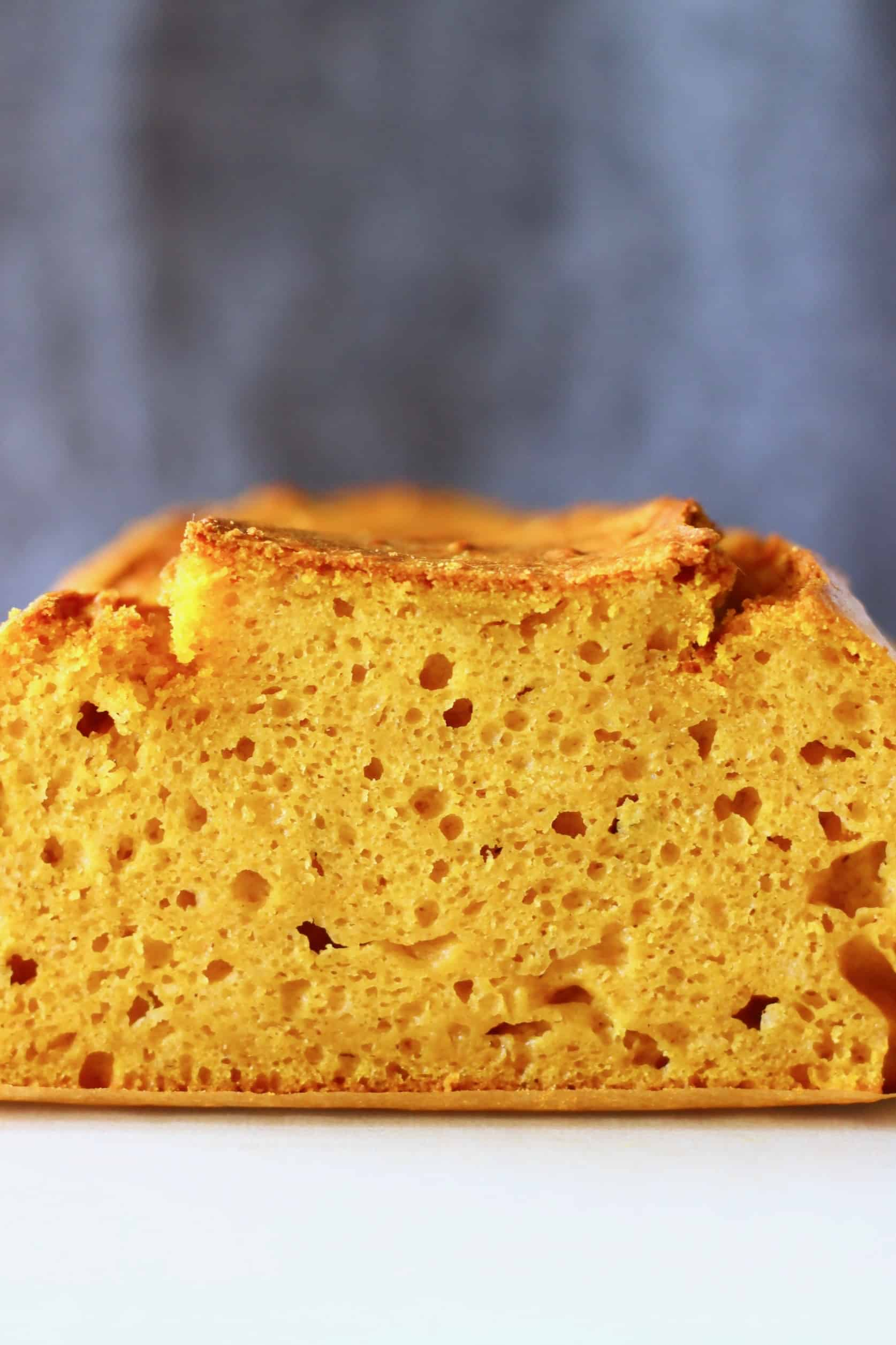A loaf of pumpkin bread against a grey background