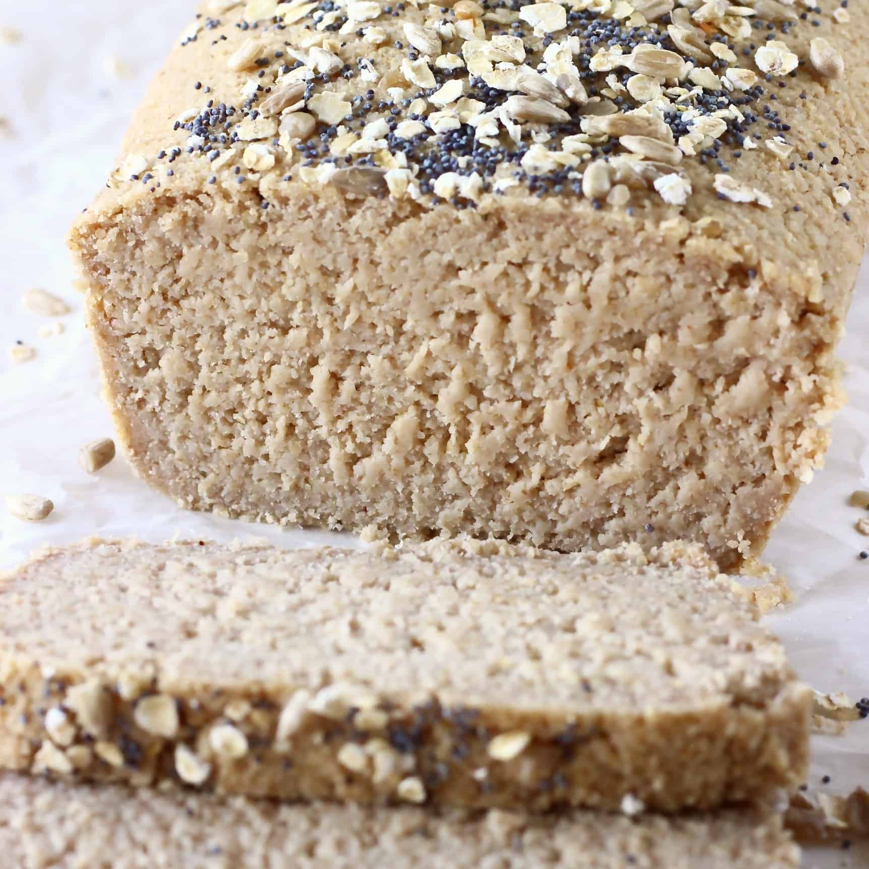 A loaf of oat flour bread with two slices