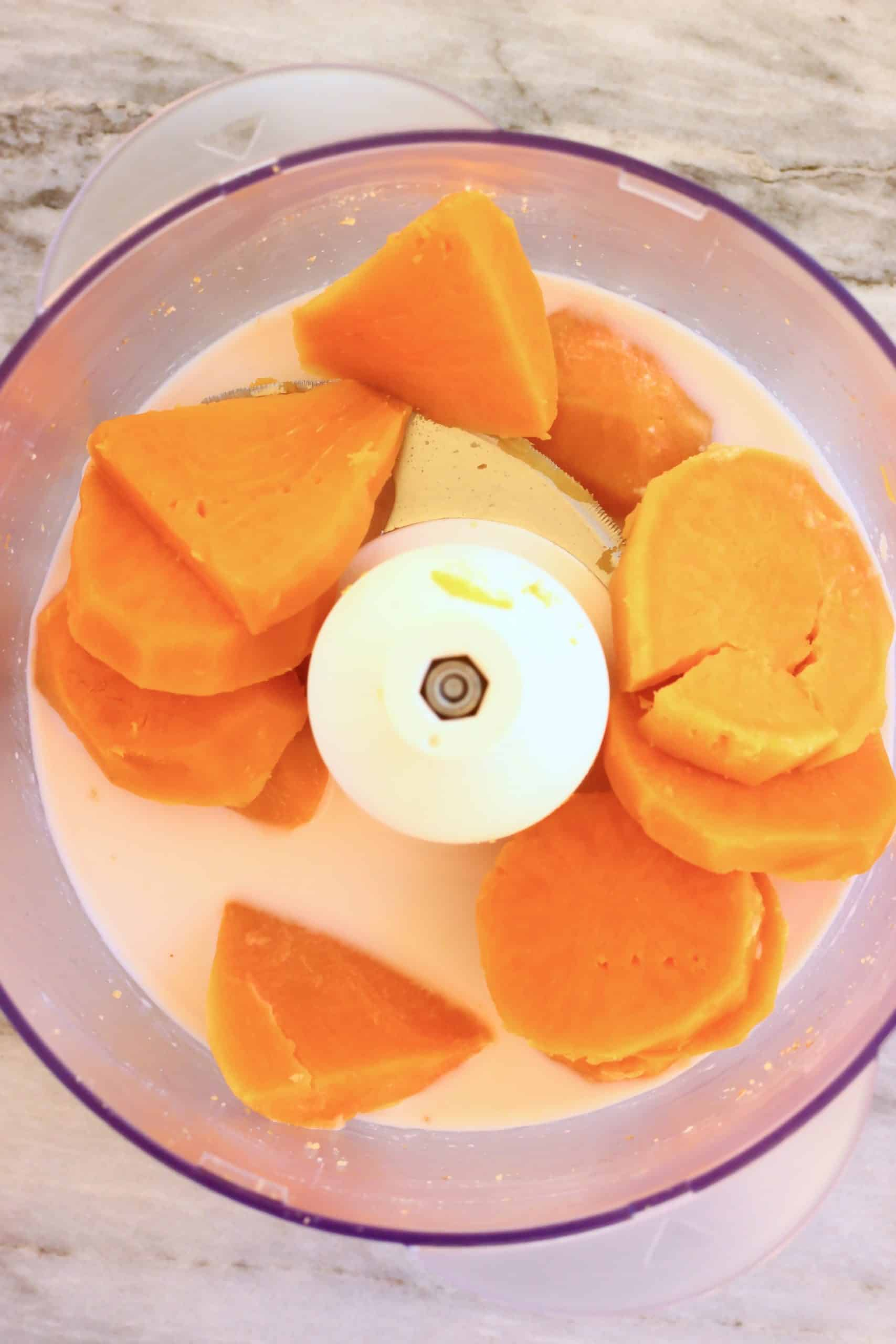 Cooked sweet potato and almond milk in a food processor