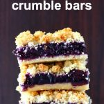 Three blueberry crumble bars stacked on top of each other