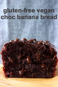 A loaf of sliced chocolate banana bread with chocolate chips