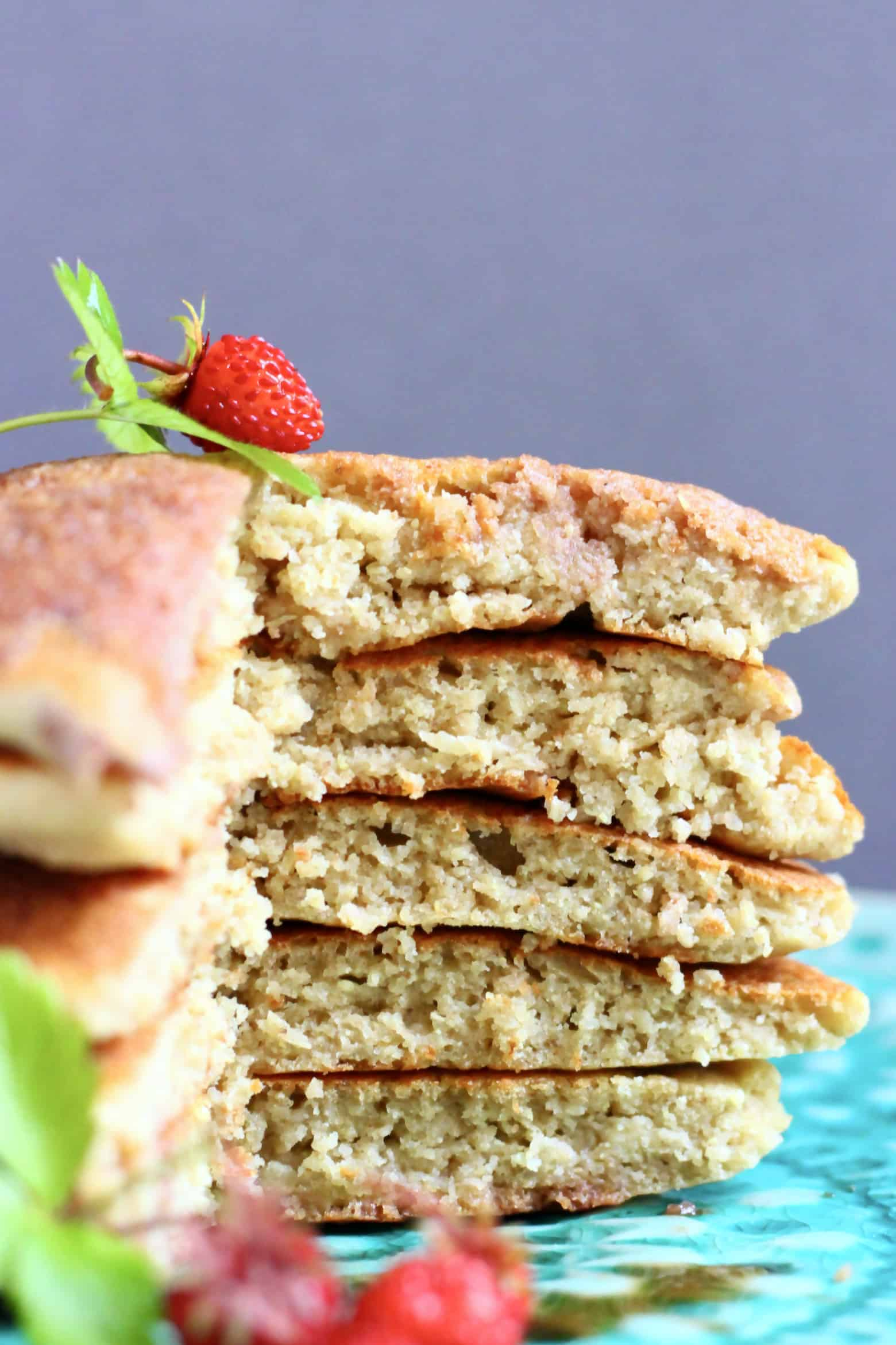 A sliced stack of five quinoa pancakes on a plate