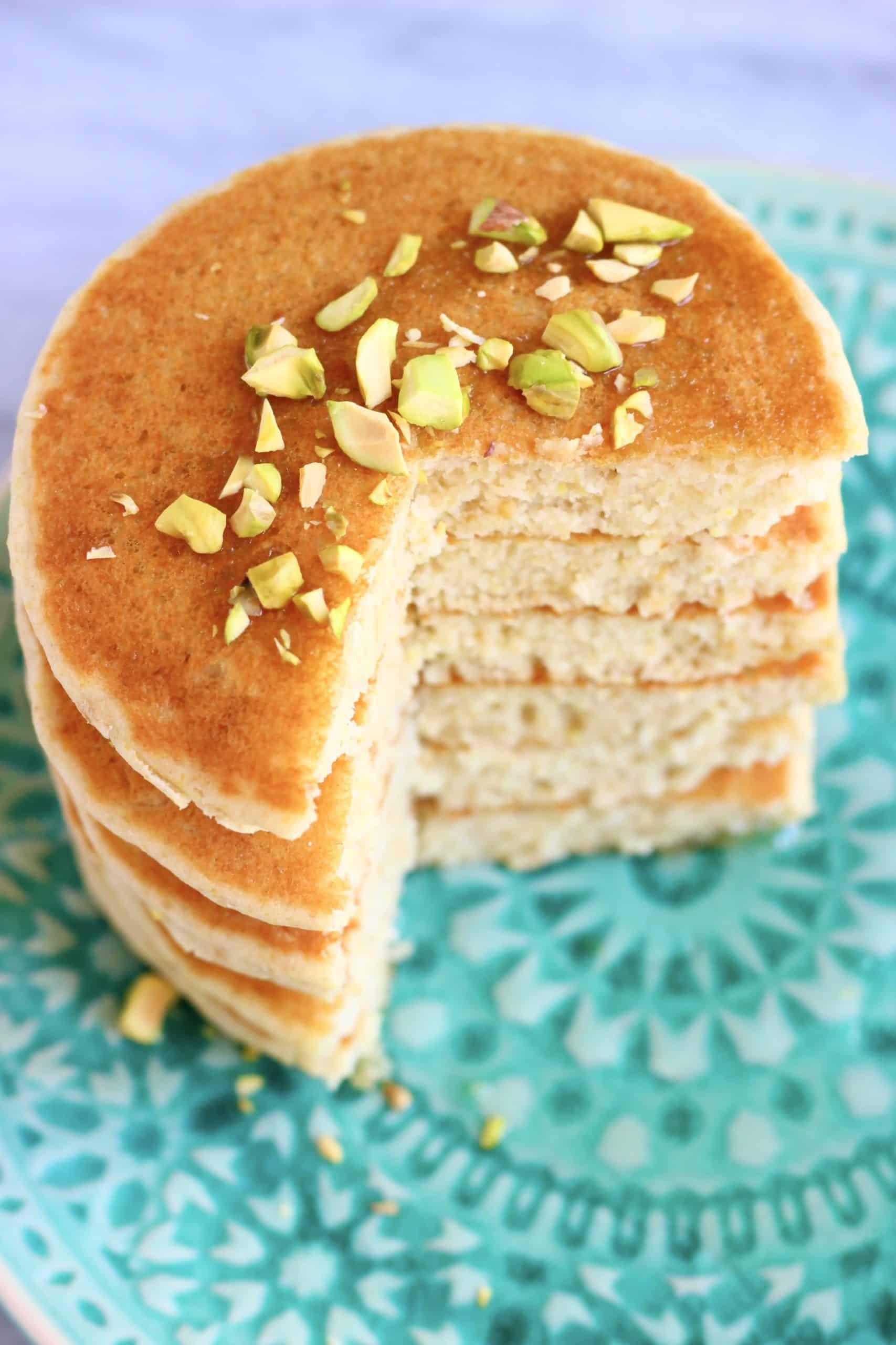 A stack of six sliced flaxseed pancakes on a plate