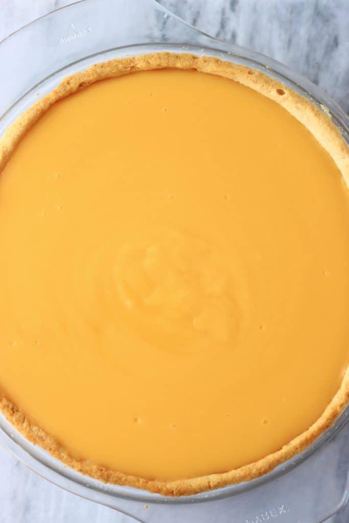 Lemon tart in a pie dish