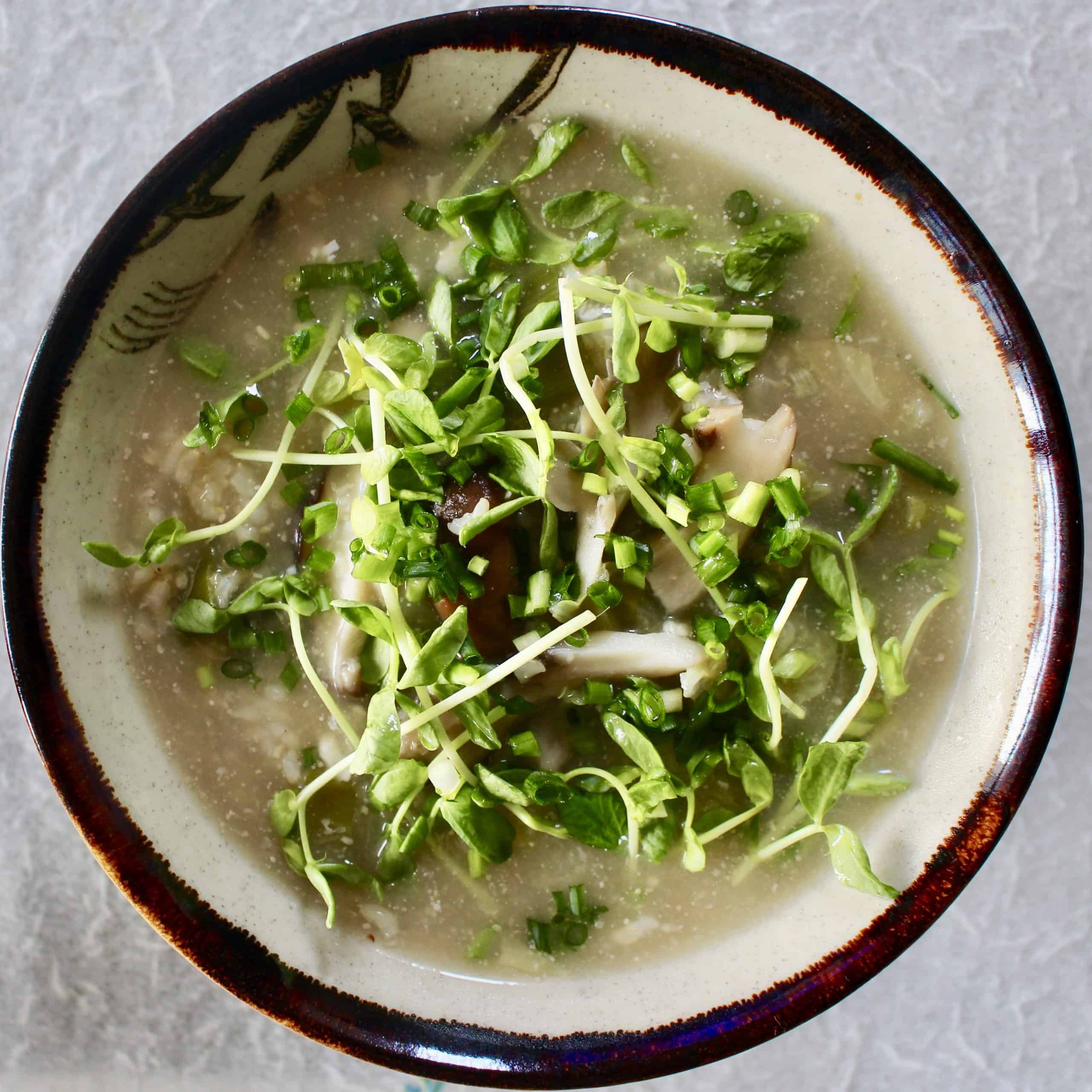 Miso brown rice soup in a brown bowl