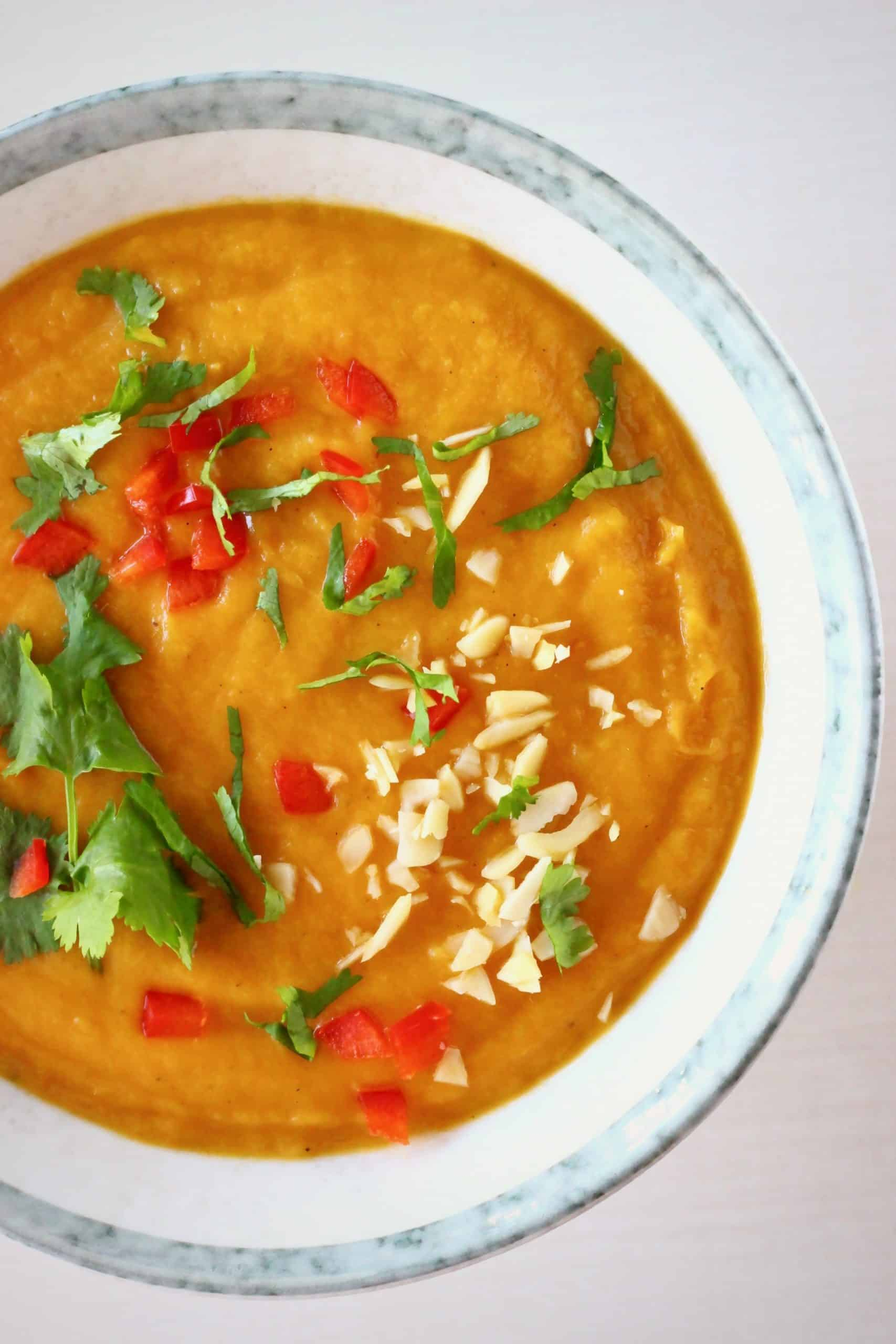 Sweet potato peanut soup in a white bowl