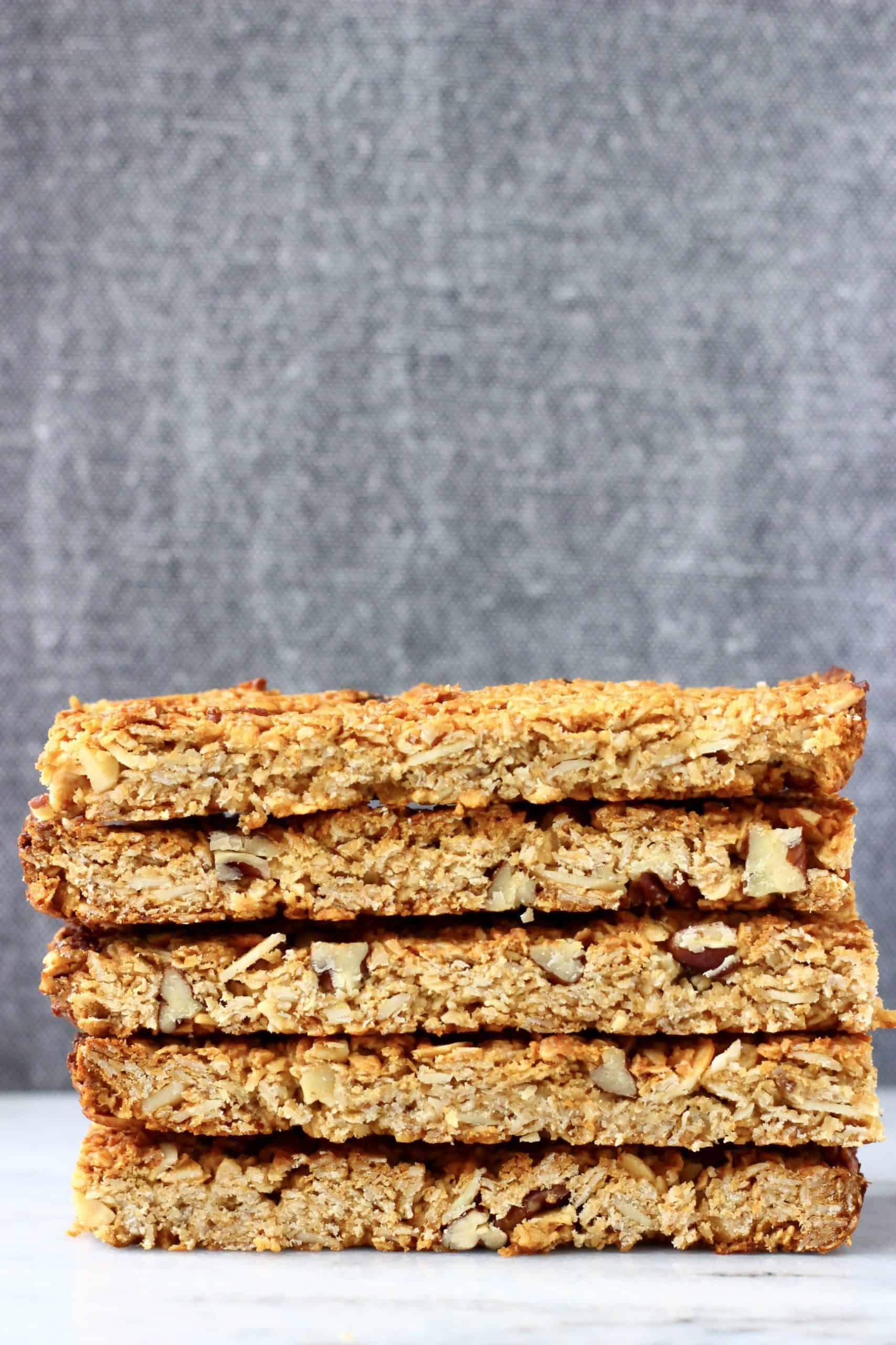 Five golden brown granola bars stacked on top of each other