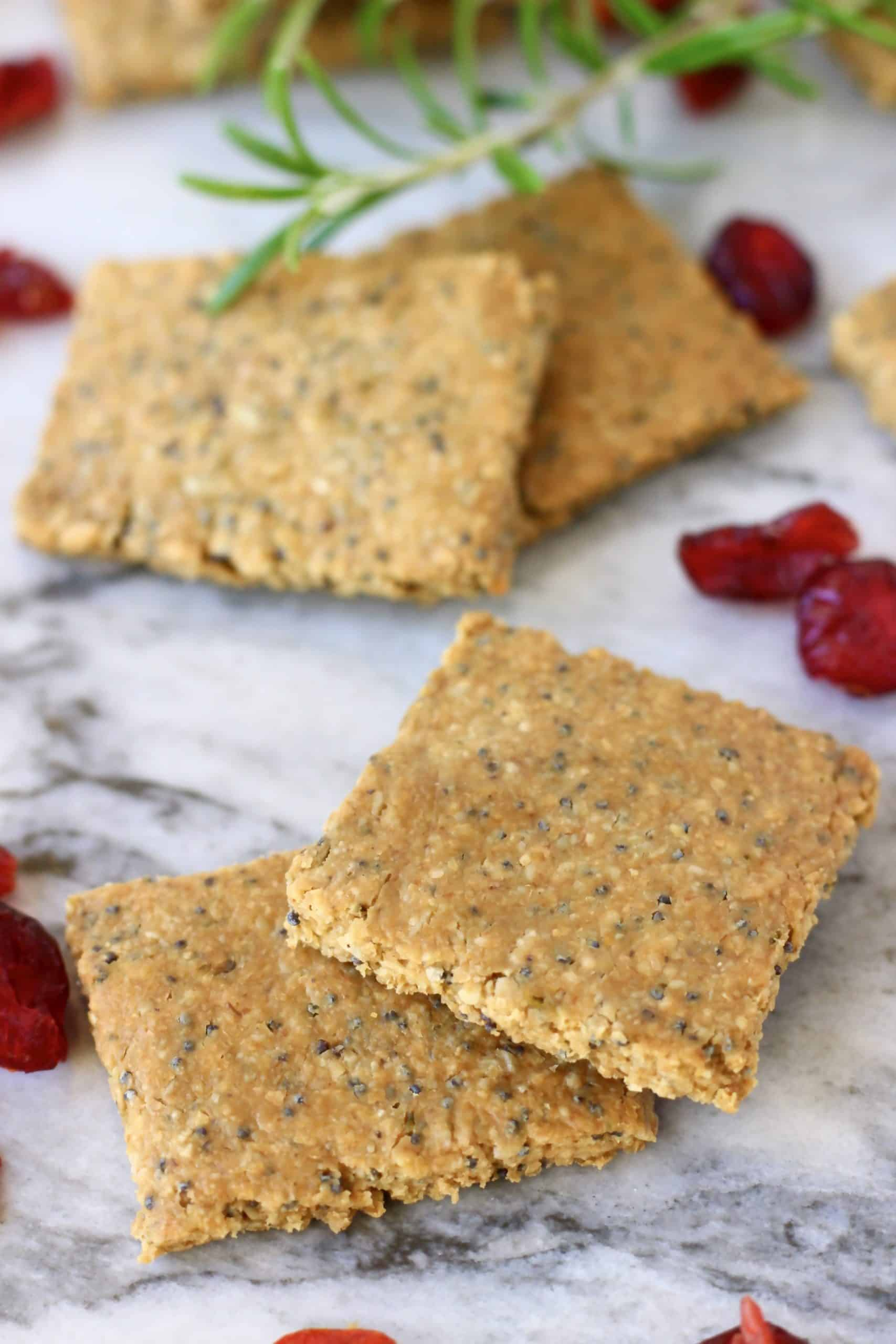 Four gluten-free vegan crackers on a marble background
